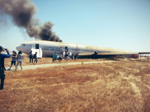 Passengers walk away from Asian Flight 214 that crash-landed at San Francisco International Airport. (Path.com photo shared by passenger David Eun @Eunner).