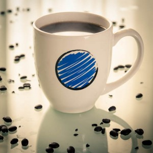 White Coffee Cup Mug with a Blue Dot, Black Circle and Blue Scribble